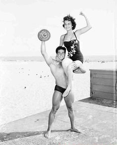 Reg Parks lifting heavy weights and a girl